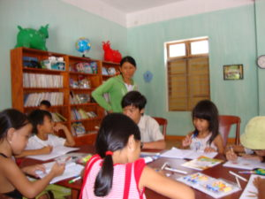 Kids enjoy playing and reading at the library in Bai Huong, Cham island