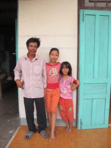 Binh happy with family on Cham island